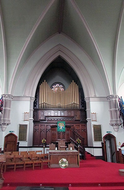 Chancel, font and organ pipes